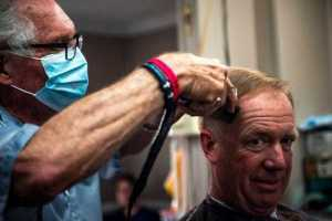 Karl Manke, 77, cuts the hair of Craig Wiker of Dowagiac at his barbershop in Owosso, on May 11, 2020. (Photo: Nic Antaya, Special to The Detroit News)