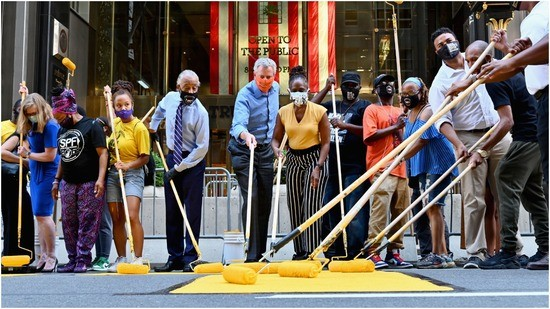 The Reverend Al Sharpton, New York Mayor Bill de Blasio and his wife Chirlane McCray, paint a new Black Lives Matter mural outside of Trump Tower on Fifth Avenue on July 9, 2020 in New York City.