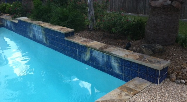 soda blasting cleans pool tile surfaces