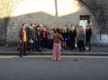 The Pop-Up Choir warming up outside Brixton East