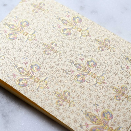 "This little notepad is 3.5"" x 5"" -- notice the gold foil!"