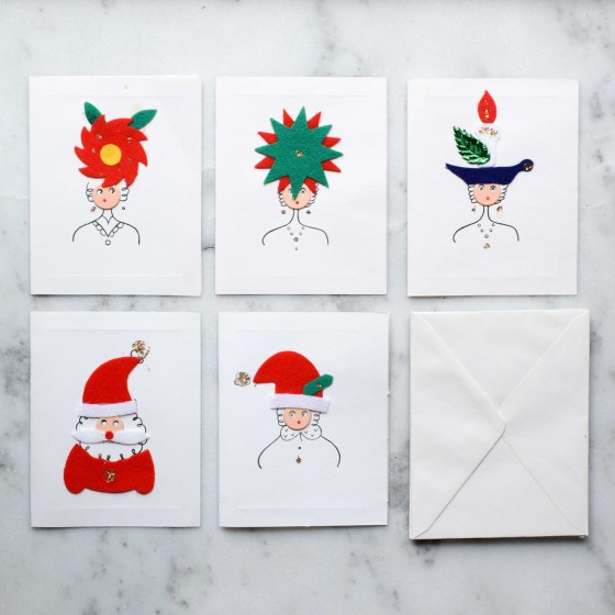 These vintage holiday cards were made in Japan and feature felt and glitter.