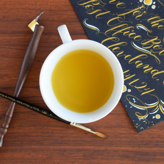 This cup will add beauty and function to your artistic workspace.