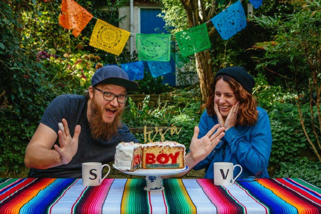 gender reveal cake with It's a boy written on it