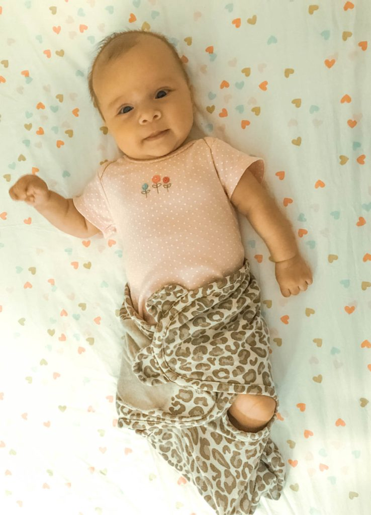 when to stop swaddling baby - baby can get out of swaddle