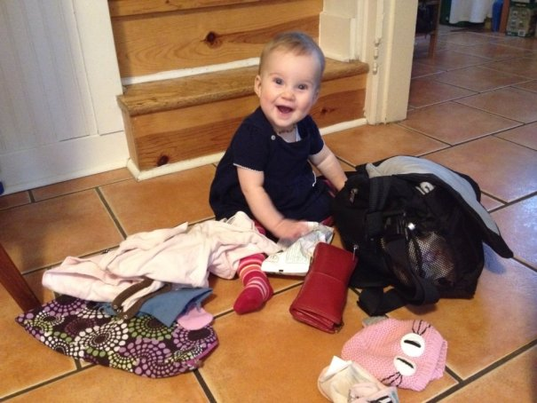 Millie is in awe of many things. Like her mom's purse and all the treasures within!