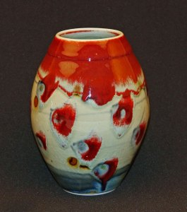 Podcasts David and Felicity porcelain vase, celadon glaze with brushwork in copper red and cobalt. reduction fired to cone 12.