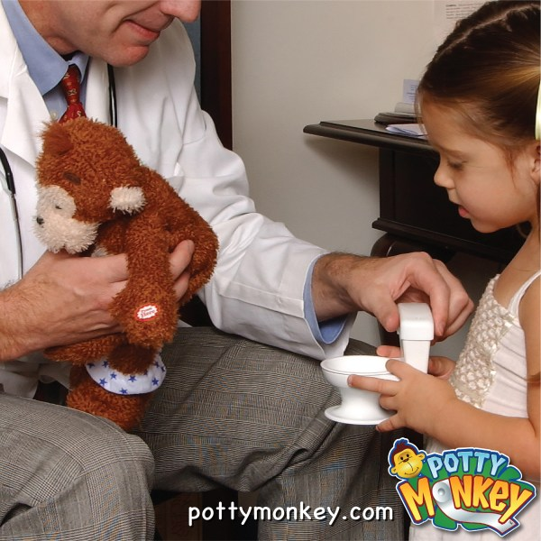 Adult and child holding potty monkey and his toilet.
