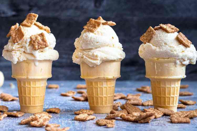 three cake cones with scoops of ice cream topped with pieces of cinnamon toast crunch ice cream are lined up in a row