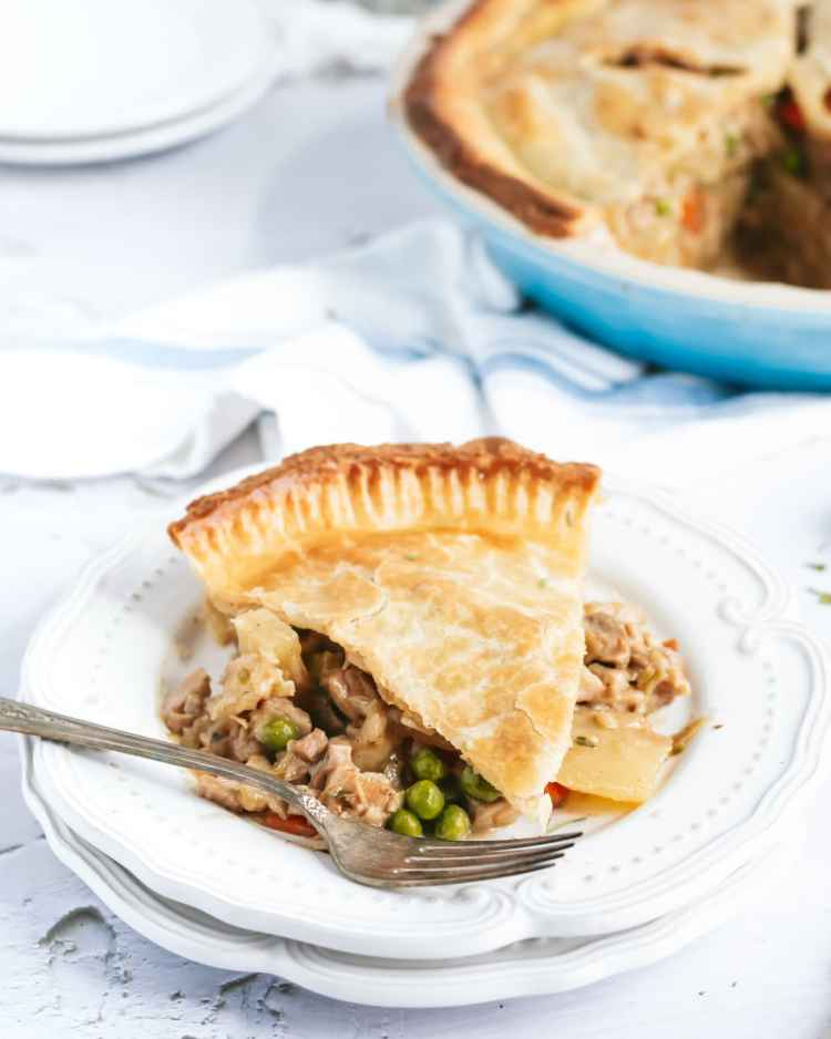 a slice of chicken pot pie on a plate