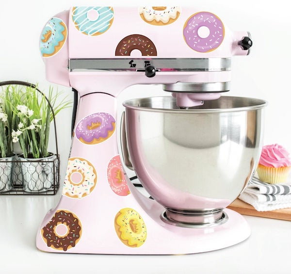 a light pink kitchenaid mixer covered in doughnut decals