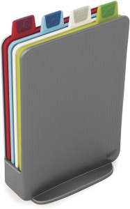 red, blue, white, and green rectangular cutting boards in a grey vertical file folder case