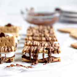 close up of a crispy meringue smore drizzled with chocolate