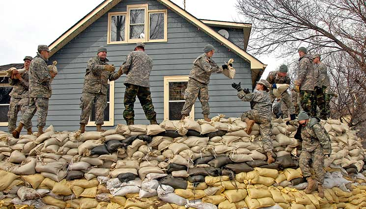 Sandbags have been used for a long time to keep us safe in dangerous situations. Safe from rising flood-waters and from incoming rounds in combat. I started thinking about sandbags in terms of home security and the dual purpose they fill struck me. In some places, the threats of floods from winter's ice thawing is a real and present threat to everything someone may own. Knowing how to build a proper sandbag wall would be important if you are faced with rising water.