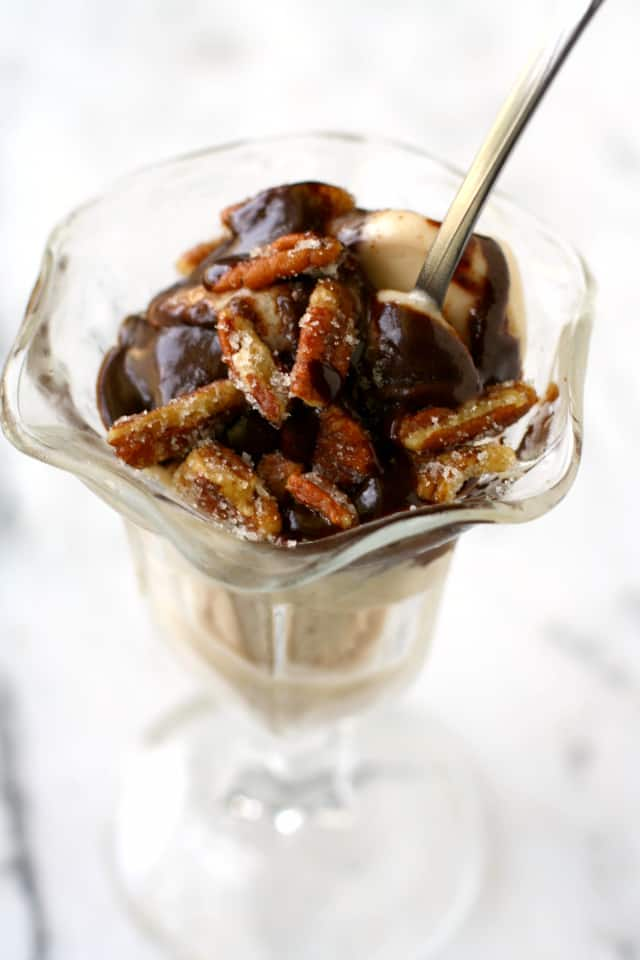 A decadent hot fudge sundae with coconut rum sauce and sugared pecans. A truly special treat!