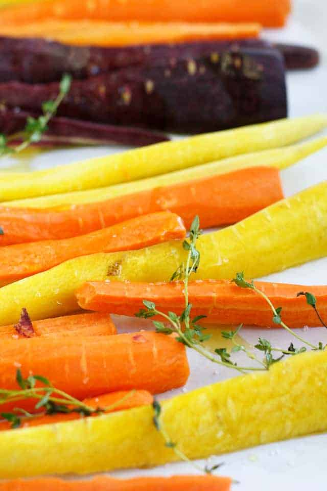 Rainbow carrots, orange, yellow, and purple varieties.