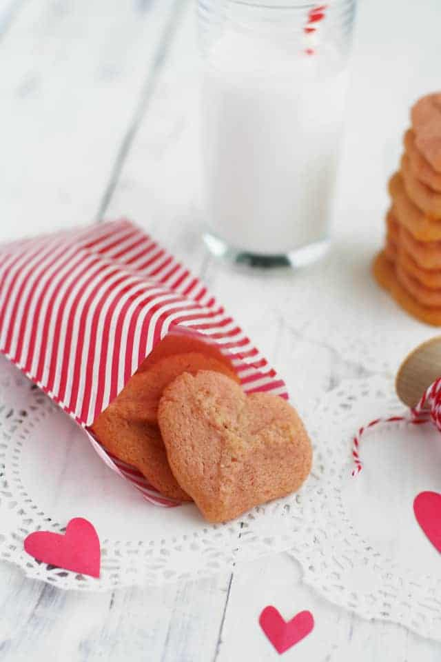 Pink heart cookies made with the cookie press! These buttery spritz cookies are sure to be a favorite!