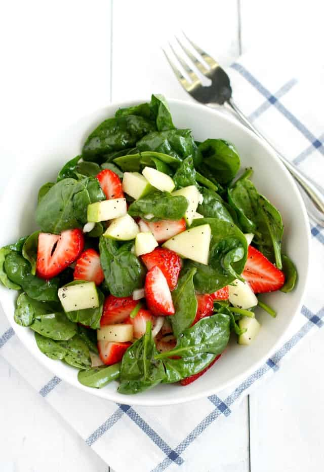 A fresh and healthy spinach strawberry salad with poppy seed dressing. A delicious and easy summer salad.