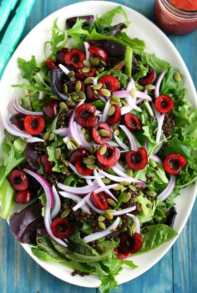 Fresh and healthy salad topped with cherries, lentils, and a cherry vinaigrette - the perfect summer recipe!