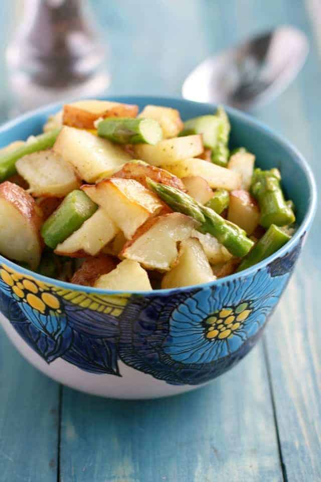 Roasted potato salad with asparagus and a Dijon mustard vinaigrette. Such a tasty summer side dish! #glutenfree #vegan