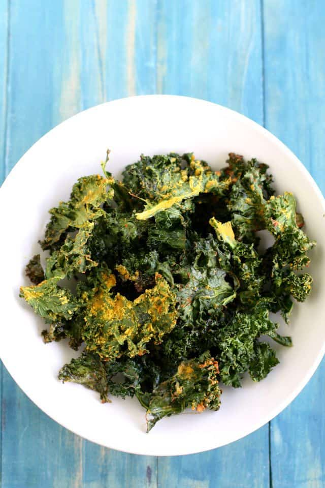 Crispy, cheesy, tasty baked kale chips. Easy and healthy recipe.