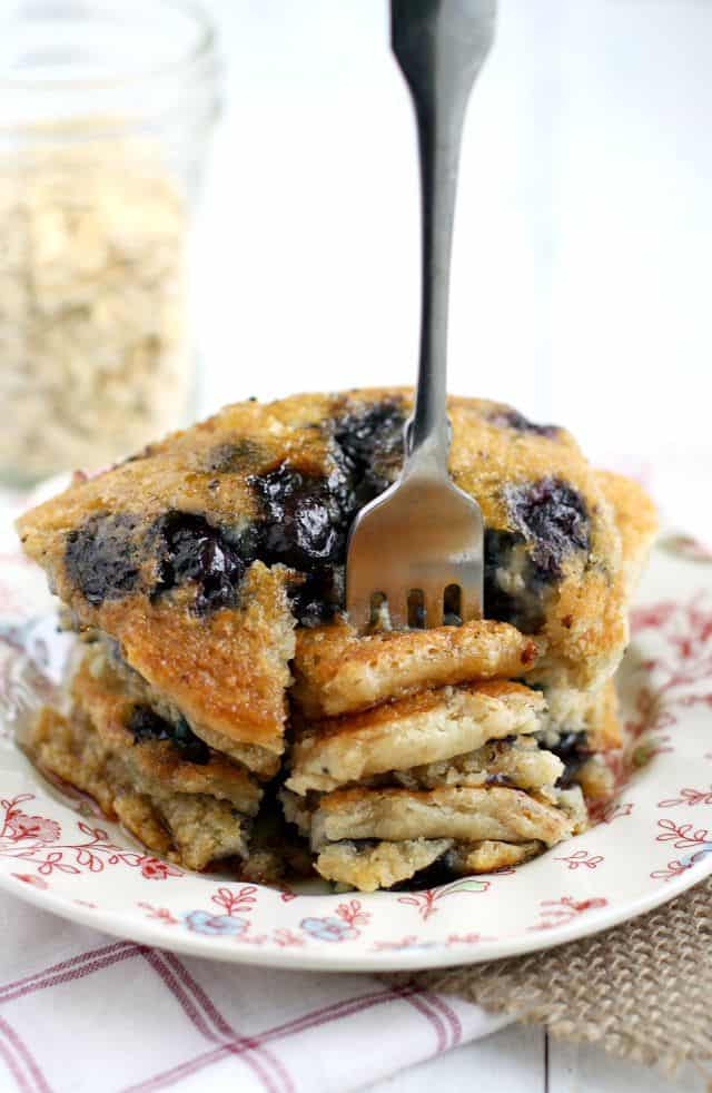 Deliciously easy blueberry oatmeal pancakes. An easy vegan pancake recipe everyone loves!