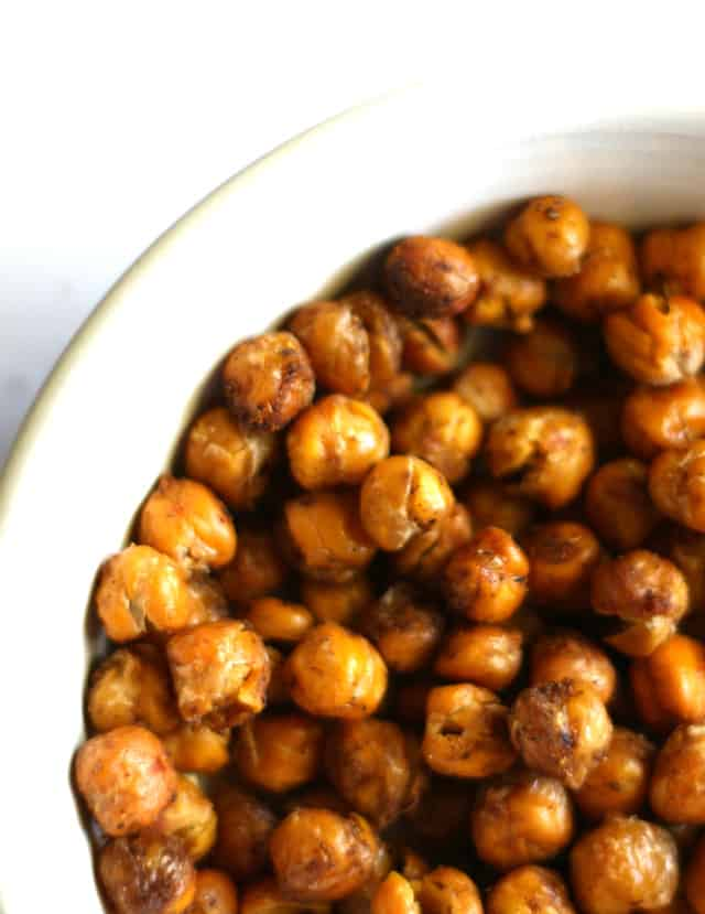Easy and flavorful spiced roasted chickpeas. These are a healthy snack that's very addictive!