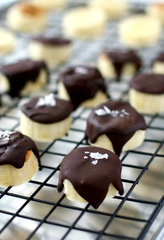 Banana slices are topped with sunbutter, chocolate, and a sprinkle of sea salt, then are frozen for a a healthy, delicious treat!