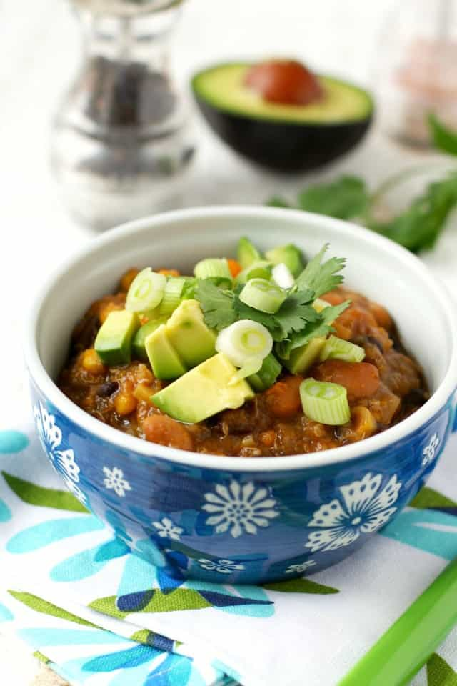 Healthy and delicious, this quinoa and sweet potato chili is made in the slow cooker. Perfect for busy days!