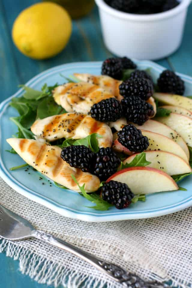 A fresh green salad topped with blackberries, apples, chicken, and a lemon poppy seed dressing. So delicious for spring! #ad #FinestBerries @driscollsberries