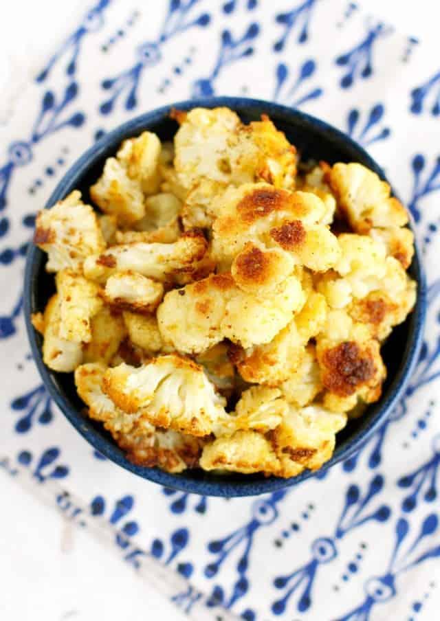 Cheesy, savory roasted cauliflower that's dairy free and vegan!