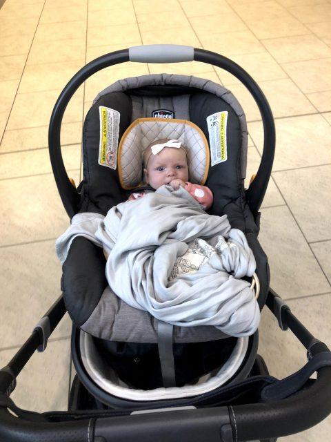 baby in a carseat at the airport