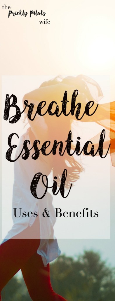 "A woman standing sideways in front of the sun with her arms bent above her head and her scarf flowing behind her with ""Breathe Essential Oil"" written on the image."
