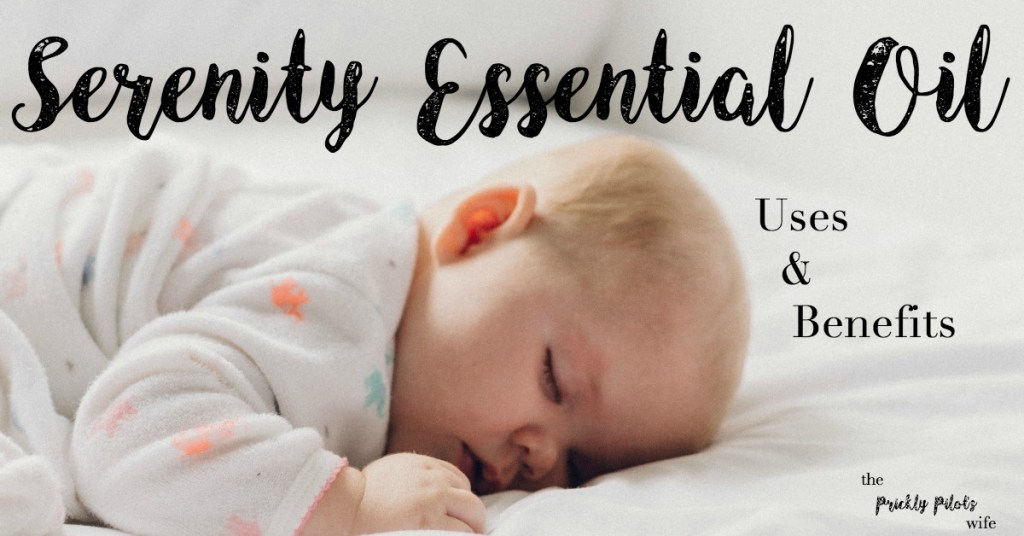 """An infant asleep on a bed with """"Serenity Essential Oil"""" written over the image."""