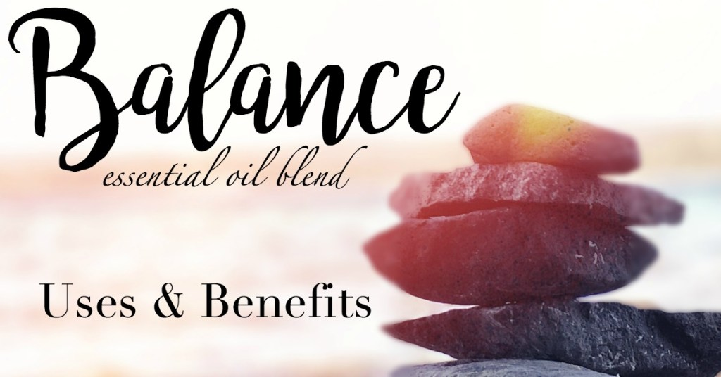 """Picture of balancing rocks in a sunburst with """"Balance essential oil blend uses and benefits"""" written over the image."""