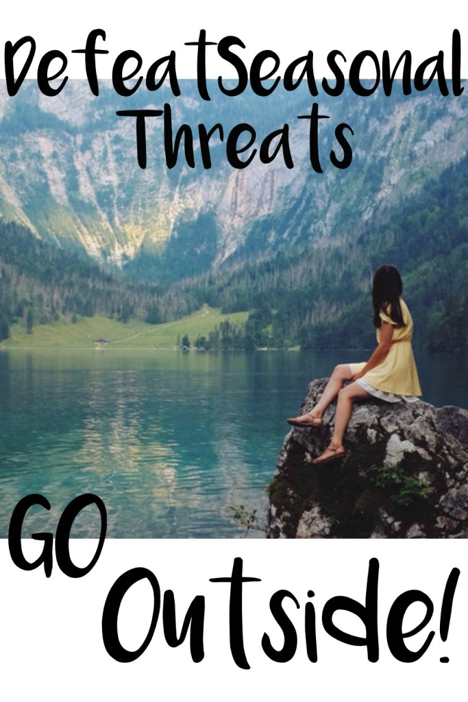 """Image of a girl in a yellow sundress sitting on a rock looking over a lake in a mountain valley with """"Defeat Seasonal Threats, Go Outside!"""" written over the image"""