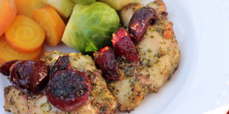 Cherry Paleo Pesto Chicken is the perfect balance of sweet and salty. Cherries and basil compliment chicken thighs in this quick and easy paleo pesto recipe - www.ThePrimalDesire.com