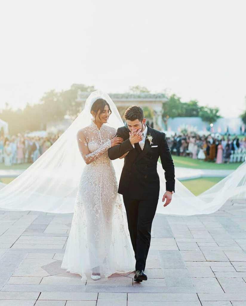 "Nick Jonas kisses new wife Priyanka Chopra's hand after saying ""i do"""