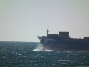 A container ship rides the waves in the Atlantic on clear day.  THE PRIVATEER CLAUSE photo