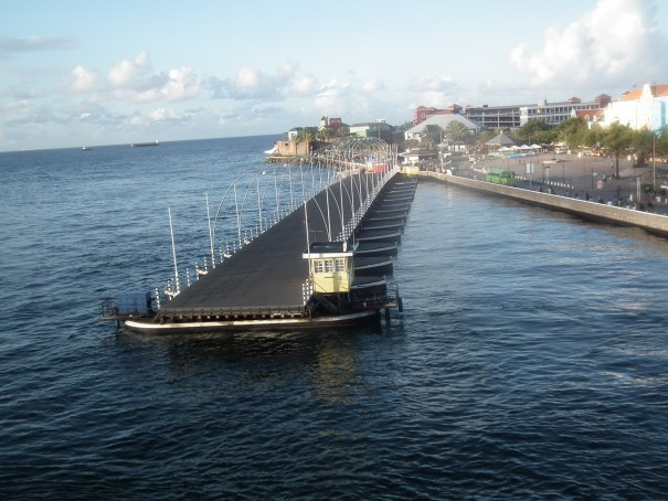 The bridge begans to swing over the harbor to reconnect both sides of the harbor at Curacao.  THE PRIVATEER CLAUSE photo