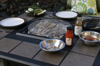 Propane Fire Pit Table becomes a Charcoal Grilling Table