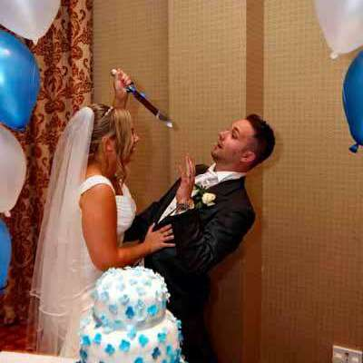 Lisa trying to stab Daz with the cake knife on our wedding day - Love