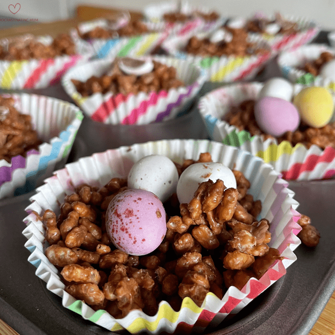 Close up shot of Easter chocolate rice crispy nests with mini eggs on top