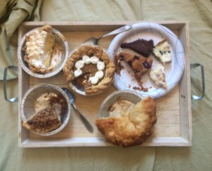 Leftovers. Clocwise from top-left: Lemon meringue pie, pumpkin pie, various tarts and quiches, double-crust apple, caramel apple streusel. NOM.