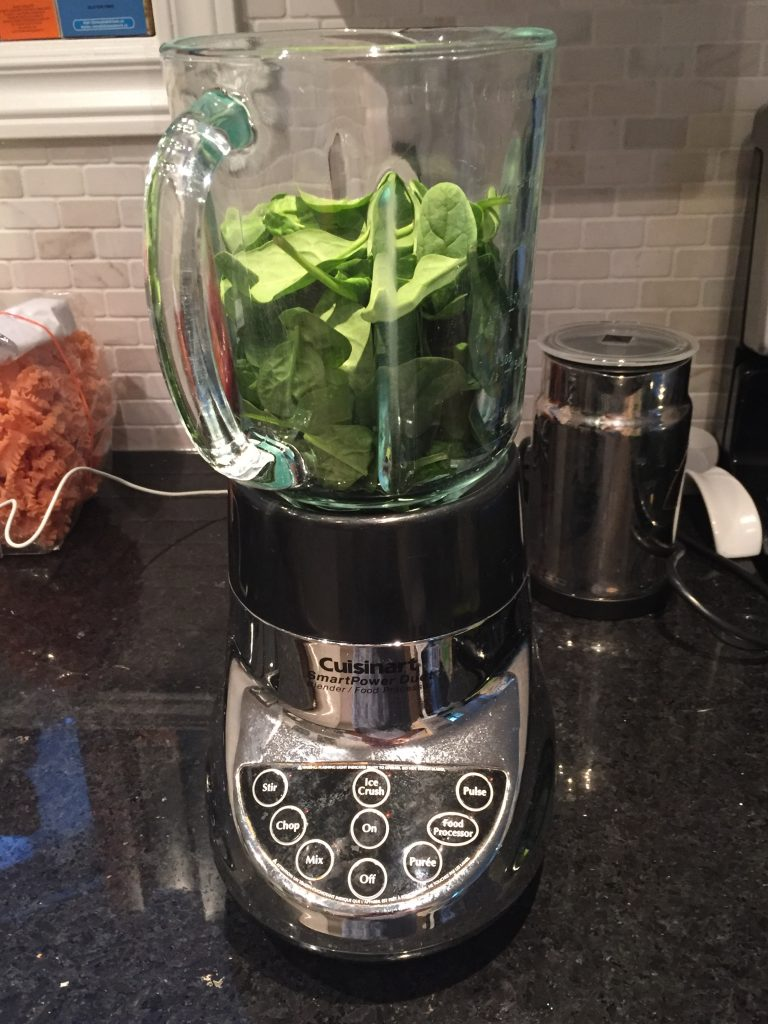 First step in making a fab vegan superfood smoothie - spinach