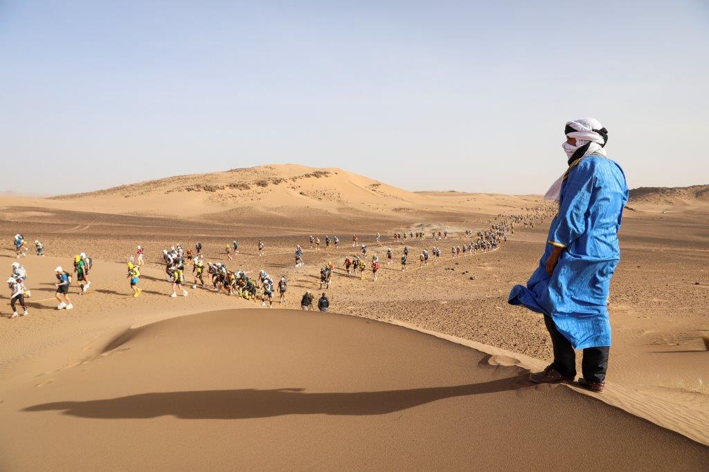 Climbing up a sand dune during the Marathon des Sables
