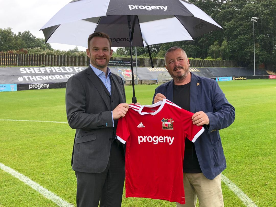 Alex Shaw, Director of Progeny, and Richard Tims, Chairman of Sheffield FC, with the team's new kit showing Progeny logo