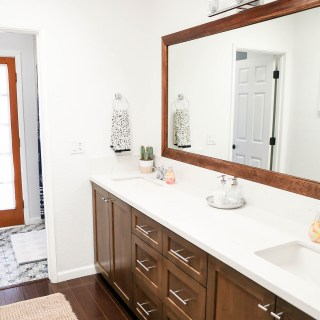 Guest bathroom renovation using Home Depot products, such as Behr Marquee in WHITE paint, Delta Silverton centerset faucets in chrome, Laurey polished chrome cabinet pulls, and a Futura 4-piece bathroom set.