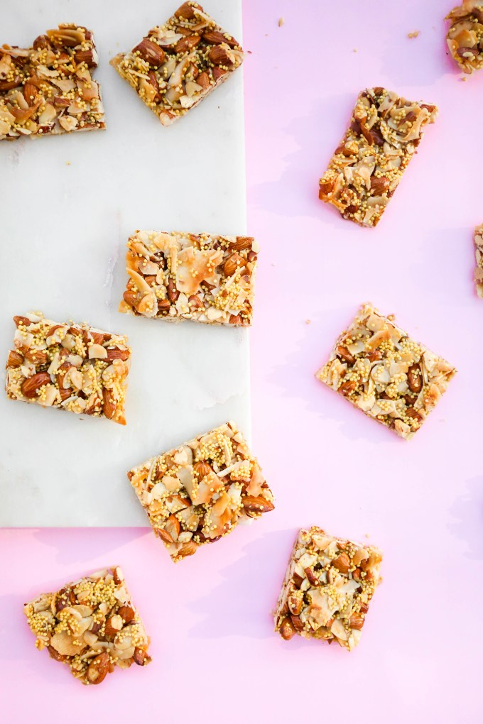 homemade granola bars on pink and marble slab
