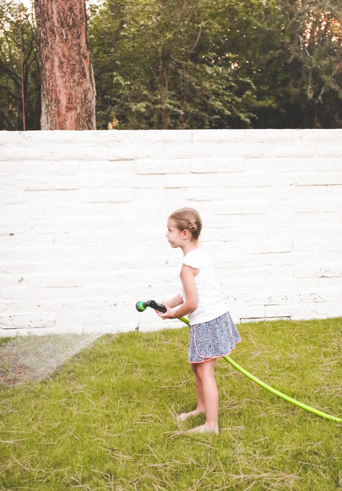 little girl holding hose